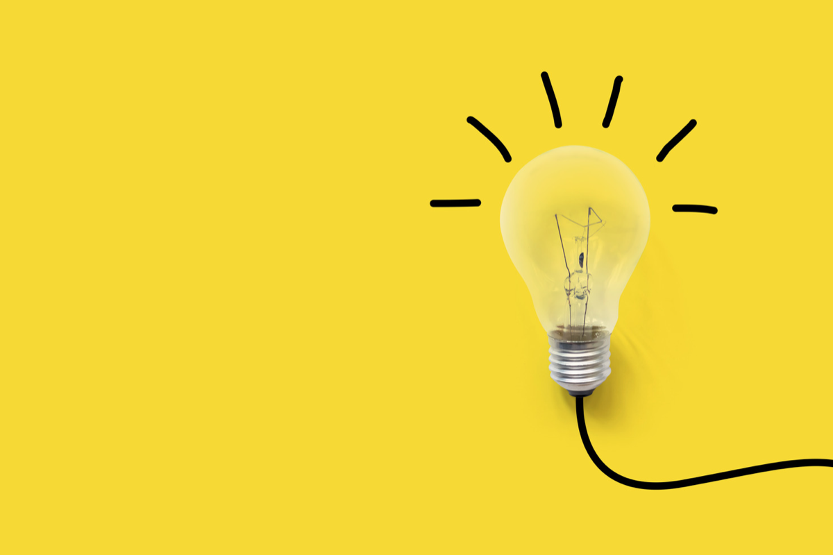 Inspiration light bulb on a yellow background